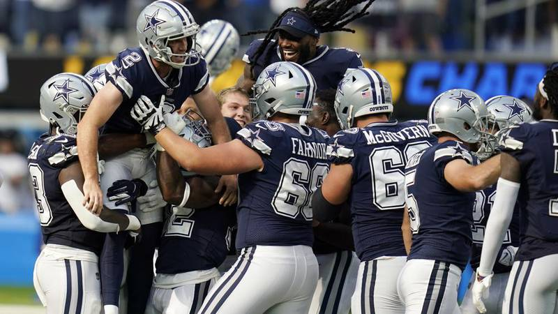 Dallas Cowboys kicker Greg Zuerlein (2) is lifted by teammates after making the game-winning...