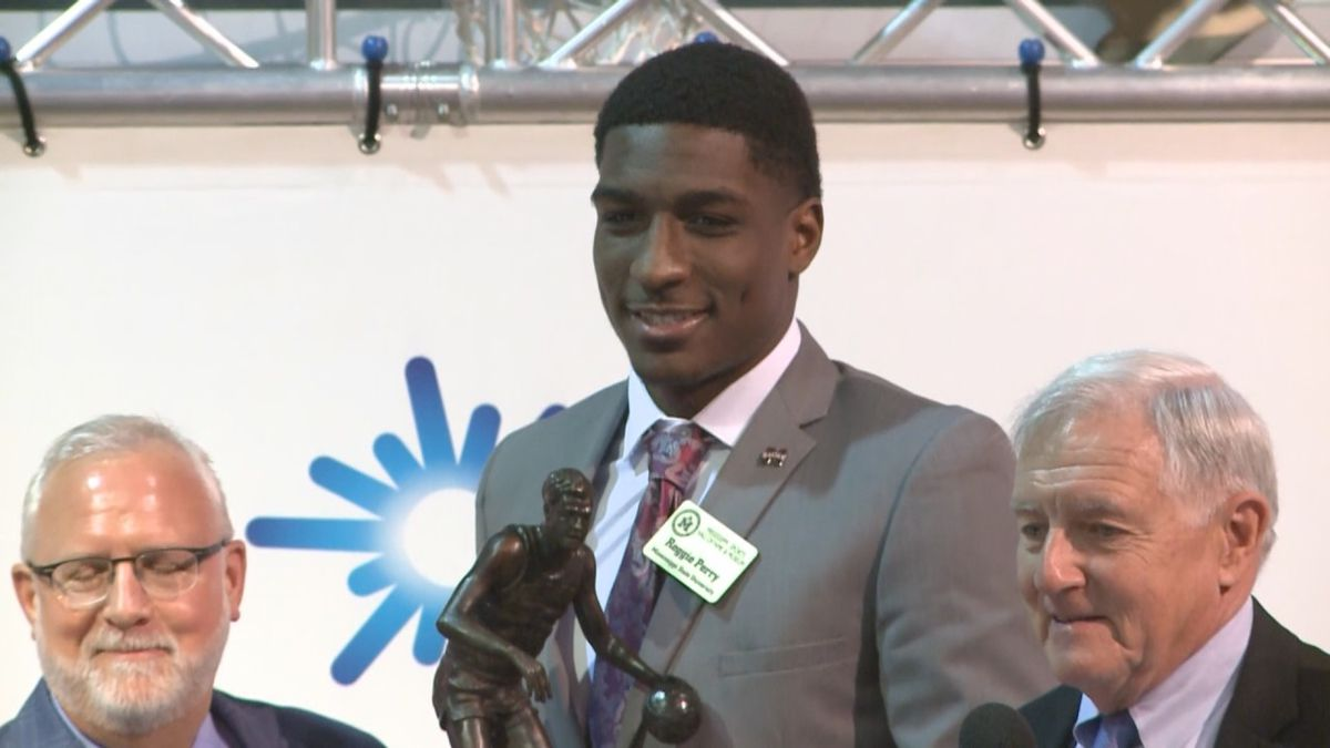 Reggie Perry accepts the C Spire Howell Trophy at the Mississippi Sports Museum in Jackson. The award is presented annually to the best player in the state of Mississippi.