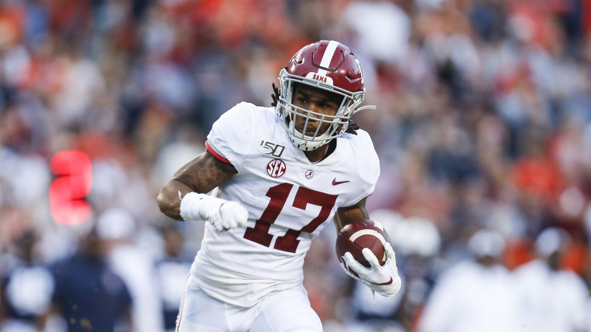 Alabama wide receiver Jaylen Waddle (17) carries the ball against Auburn during an NCAA college...