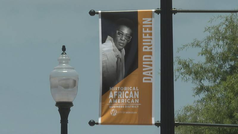 About a dozen banners depicting the names and faces of locals who paved the way for others and...