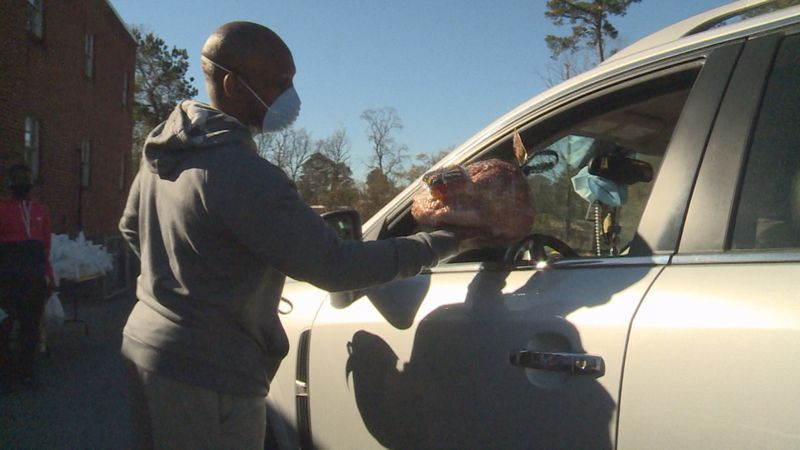 Hundreds of free turkey and ham were given away to families who are in need.