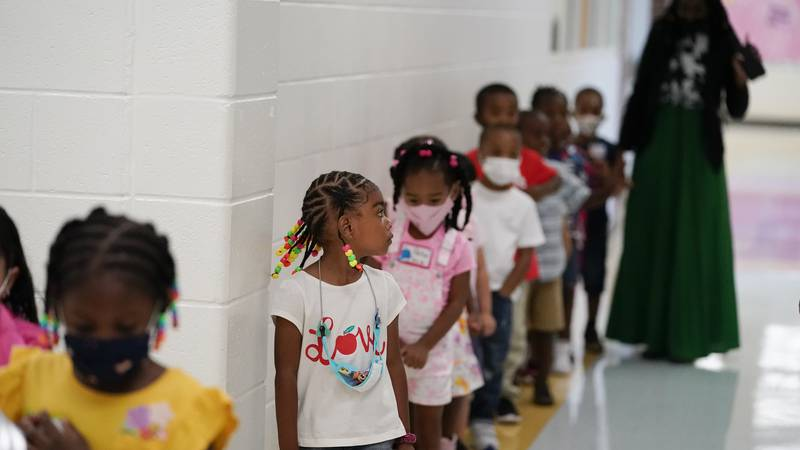 Students walk down the hallway at Tussahaw Elementary school on Wednesday, Aug. 4, 2021, in...