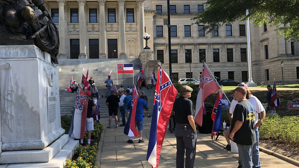 Residents gathered in Jackson to protest for the retired state flag.