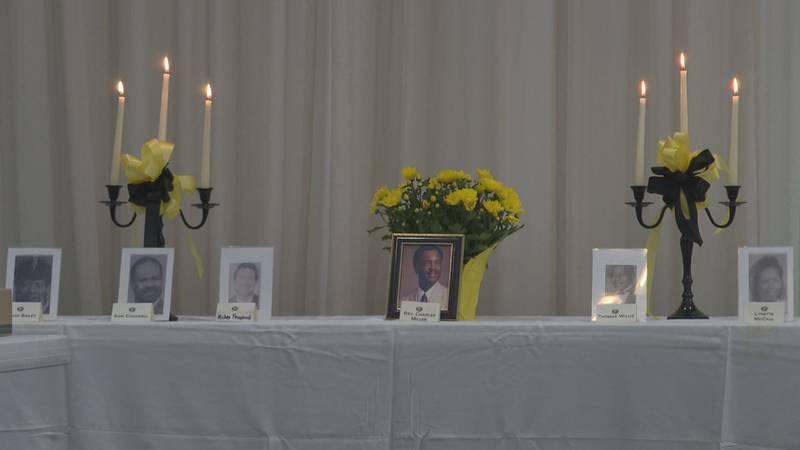 Friends and families of the 2003 Lockheed Martin shooting victims stood as their loved one's...