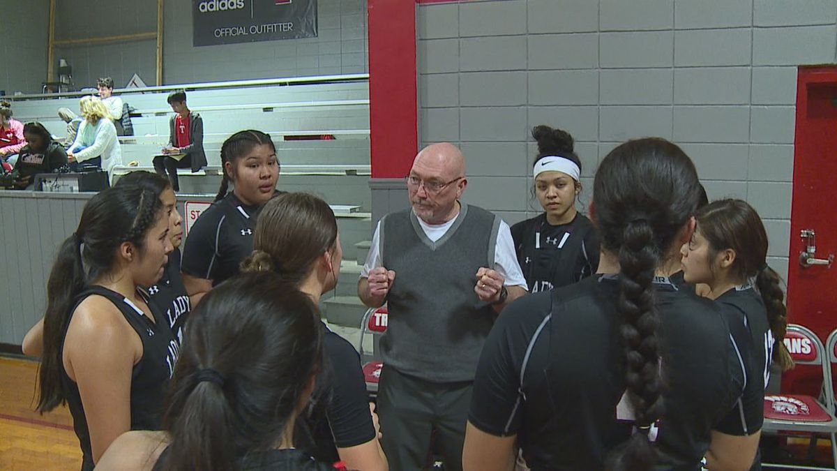 Choctaw Central head coach Bill Smith rallies the Lady Warriors together during a timeout