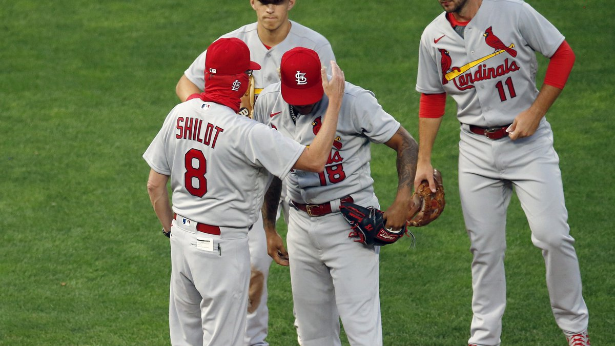 St. Louis Cardinals manager Mike Shildt (8) consoles pitcher Carlos Martinez on the cap as he...
