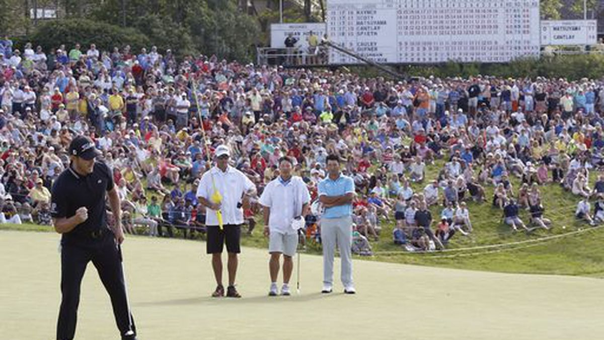 Patrick Cantlay, left, reacts after making par on 18th hole during the Memorial golf tournament Sunday, June 2, 2019, in Dublin, Ohio. (AP Photo/Jay LaPrete)
