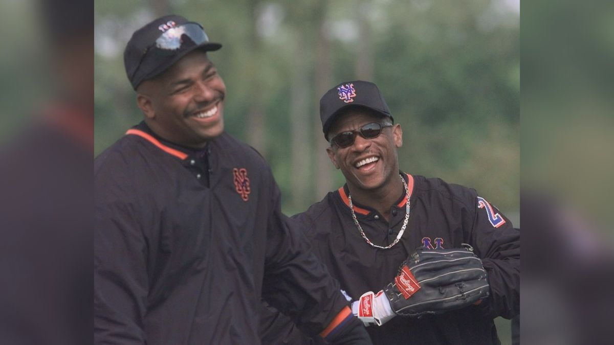 New York Mets outfielders Bobby Bonilla, left, and Rickey Henderson joke around at spring training Tuesday, Feb. 23, 1999 in Port St. Lucie, Fla. Bonilla played in 1998 for the Florida Marlins and Los Angeles Dodgers. Henderson was with the Oakland A's. (AP Photo/Mark Lennihan)