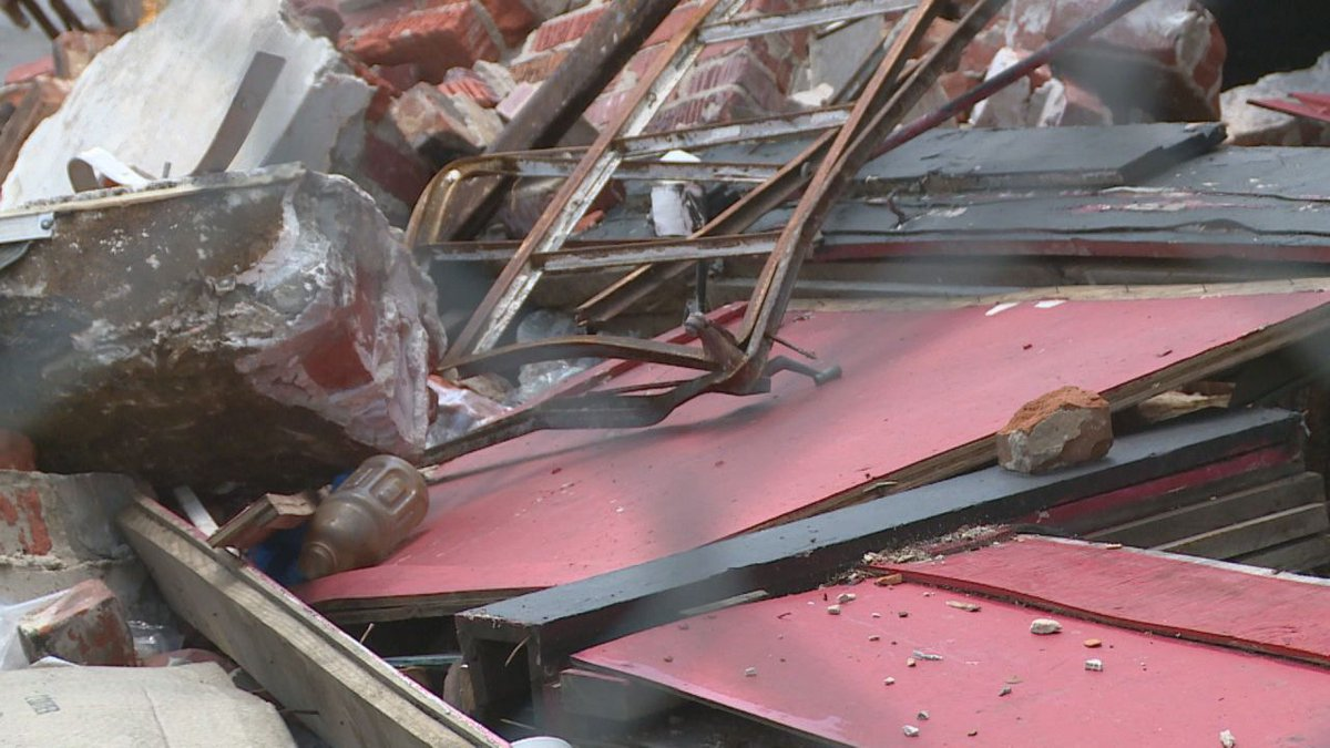 Debris remains untouched at collapsed building site in Meridian.