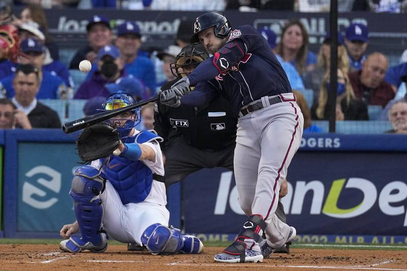 Atlanta Braves' Adam Duvall celebrates his solo home run in the second inning against the Los...