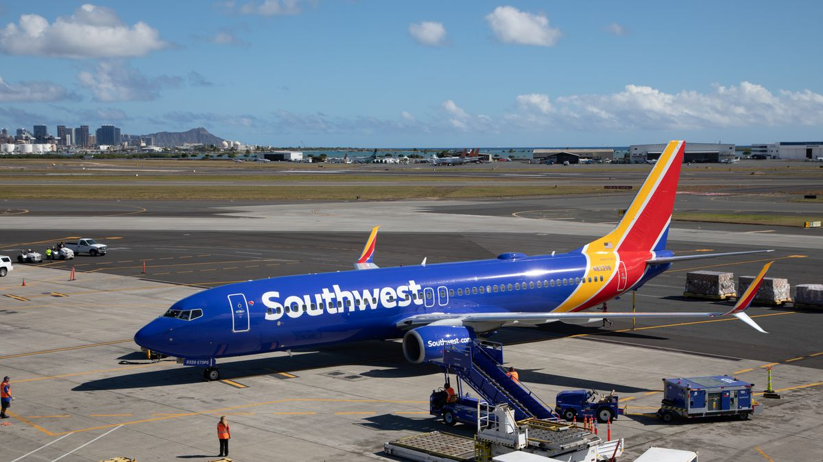 Southwest flight attendant Jessica Jackson gave mom a break and took the baby during her preflight routine.