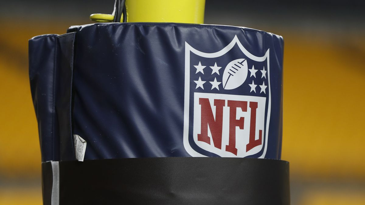 FILE - In this Dec. 15, 2019, file photo, The NFL logo NFL is on the goal post at Heinz Field...