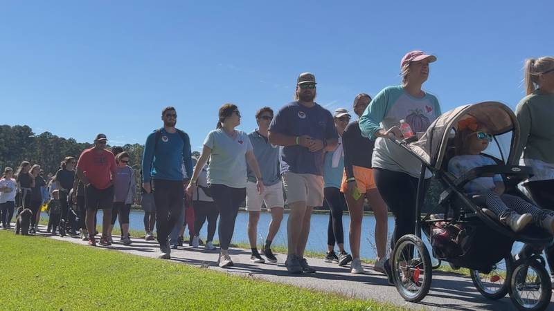 People that love to walk laced up their shoes and took steps to bring awareness of diabetes in...