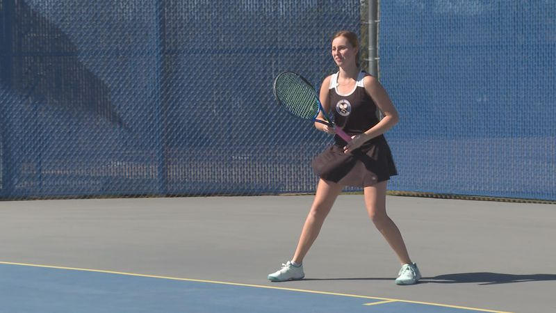 Marilyn Tullos competes in tennis and cross country for Newton County