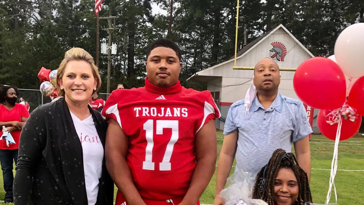 "Northeast Lauderdale football player Corey Moss was honored during the Trojan's ""Senior Night"" on Friday"