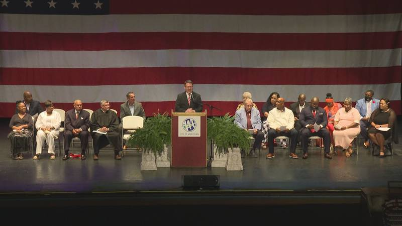 Mayor, council members sworn in during ceremony at the Temple Theatre Thursday evening.