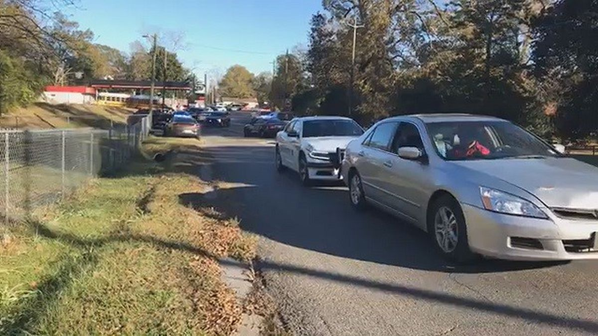The scene near State Boulevard is chaotic as officers search for a suspect or suspects accused...