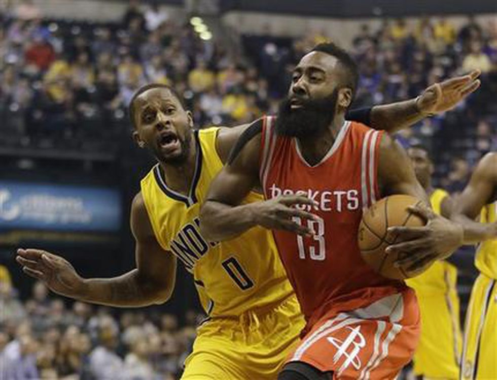 Houston Rockets' James Harden (13) goes to the basket against Indiana Pacers' C.J. Miles (0) during the first half of an NBA basketball game Monday, March 23, 2015, in Indianapolis. (AP Photo/Darron Cummings)