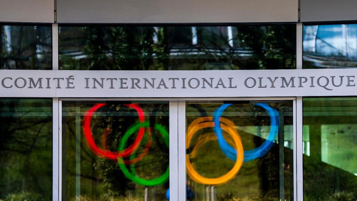 The Olympic Rings are displayed at the entrance of the IOC, International Olympic Committee headquarters during the coronavirus disease (COVID-19) outbreak in Lausanne, Switzerland, Tuesday, March 24, 2020. (Jean-Christophe Bott/Keystone via AP