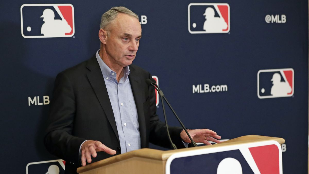 FILE - In this Feb. 6, 2020, file photo, Baseball Commissioner Rob Manfred answers questions...