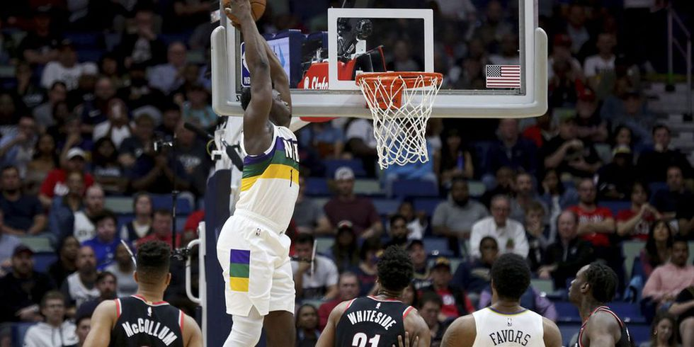 New Orleans Pelicans forward Zion Williamson (1) dunks the ball against the Portland Trail Blazers in the first half of an NBA basketball game in New Orleans, Tuesday, Feb. 11, 2020. (AP Photo/Rusty Costanza)