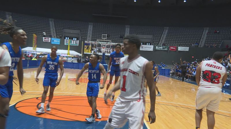 Newton boys basketball celebrates a 3-point make from Darrius Thames in the MHSAA 2A State...