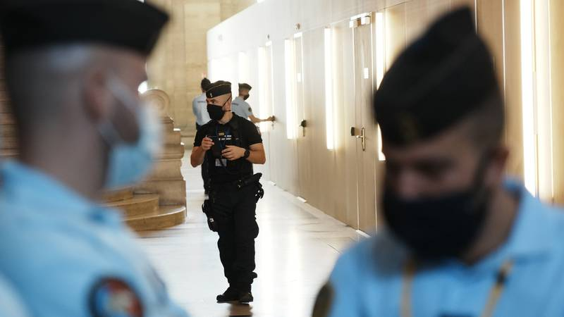 Police forces guard the special courtroom Wednesday, Sept. 8, 2021 in Paris. In a secure...