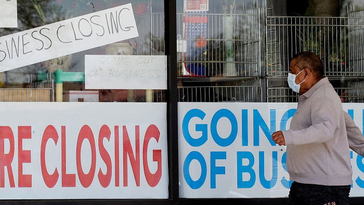 In this May 21, 2020 file photo, a man looks at signs of a closed store due to COVID-19 in Niles, Ill. U.S. businesses shed 2.76 million jobs in May, as the economic damage from the historically unrivaled coronavirus outbreak stretched into a third month. The payroll company ADP reported Wednesday that businesses have let go of a combined 22.6 million jobs since March. (Source: AP Photo/Nam Y. Huh/AP)