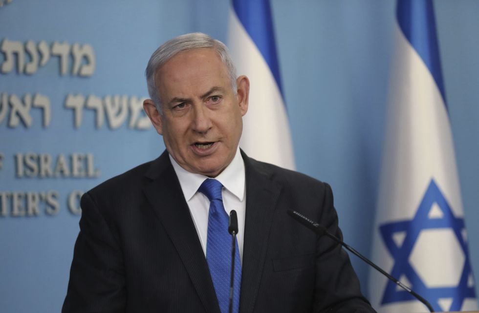 """Israeli Prime Minister Benjamin Netanyahu announces full diplomatic ties will be established with the United Arab Emirates, during a news conference on Thursday, Aug. 13, 2020 in Jerusalem.  In a nationally broadcast statement, Netanyahu said the """"full and official peace"""" with the UAE would lead to cooperation in many spheres between the countries and a """"wonderful future"""" for citizens of both countries."""