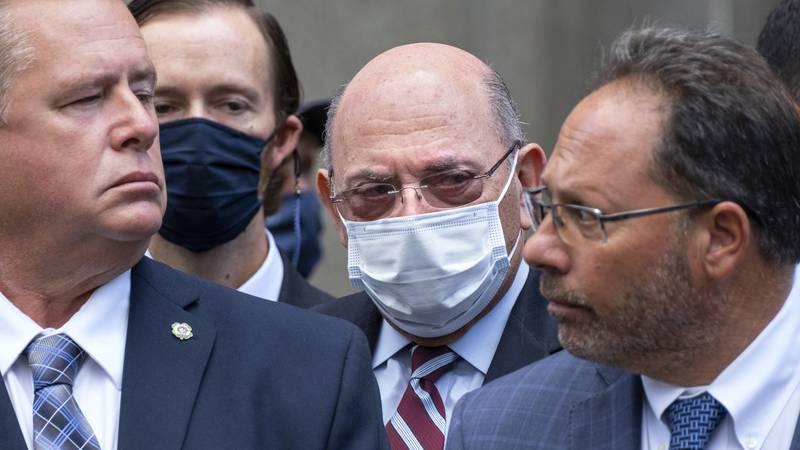 The Trump Organization's Chief Financial Officer Allen Weisselberg, center, awaits a car after...